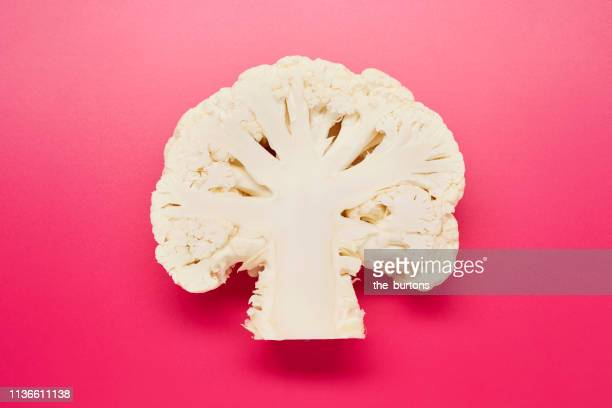 still life of sliced cauliflower on pink background - cauliflower stock pictures, royalty-free photos & images