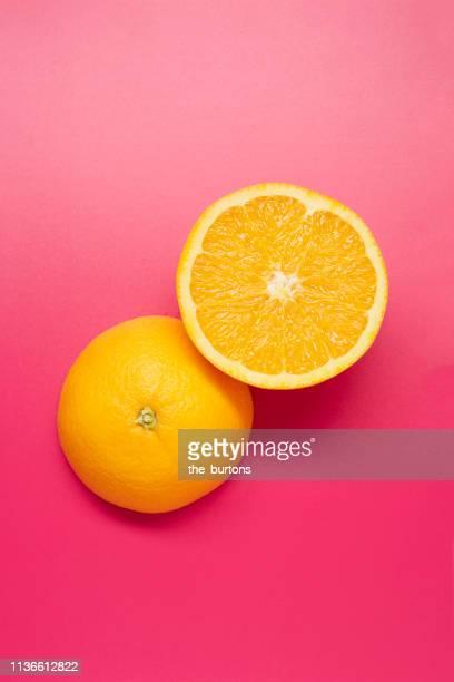 still life of sliced oranges on pink background - servierfertig stock-fotos und bilder