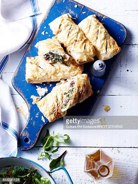 Still life of spinach and beetroot green filo pastries