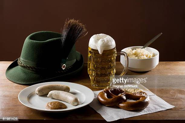 Still life of stereotypical German food, beer and hat