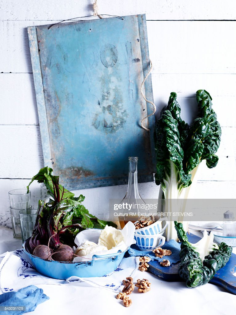 Still life of super food with walnuts, chard and beetroot : Stock Photo