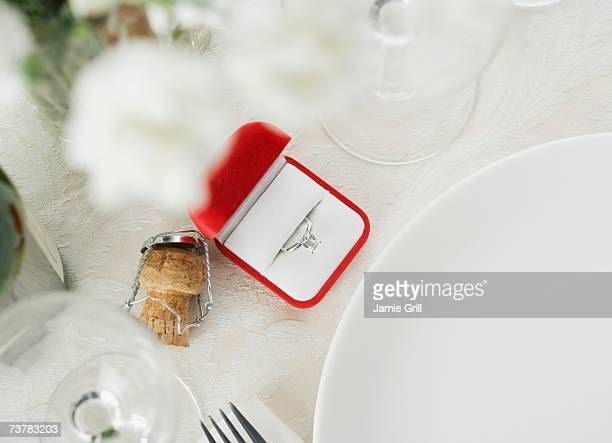 still life of table setting and engagement ring - engagement ring box stock photos and pictures