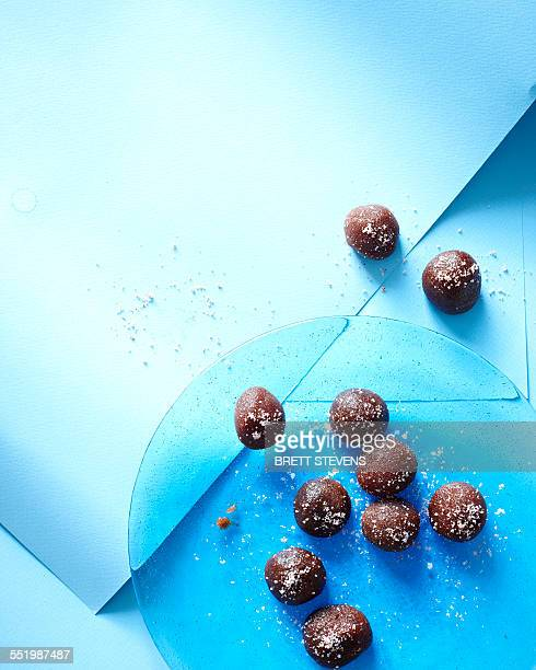 Still life of tamarind chocolate truffles on blue plate