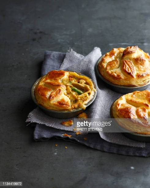 still life of three chicken pies made with puff pastry - savory food stock pictures, royalty-free photos & images