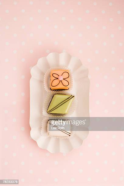 still life of three petit fours on paper plate