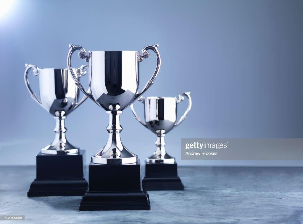 Still life of three trophies awaiting the winners presentation : Stock Photo