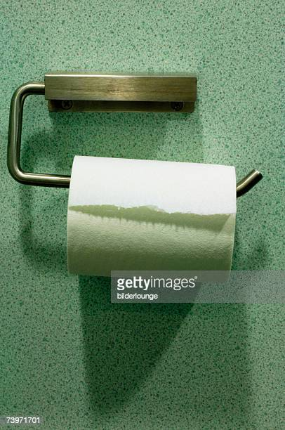 still life of toilet paper roll and holder