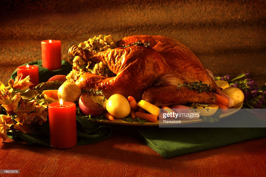 Still Life Of Turkey Platter Surrounded By Candles For Thanksgiving Dinner Stock Photo