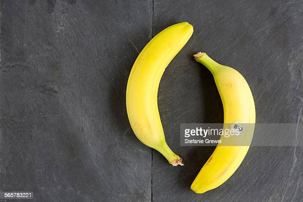 Still life of two bananas - one with bio label