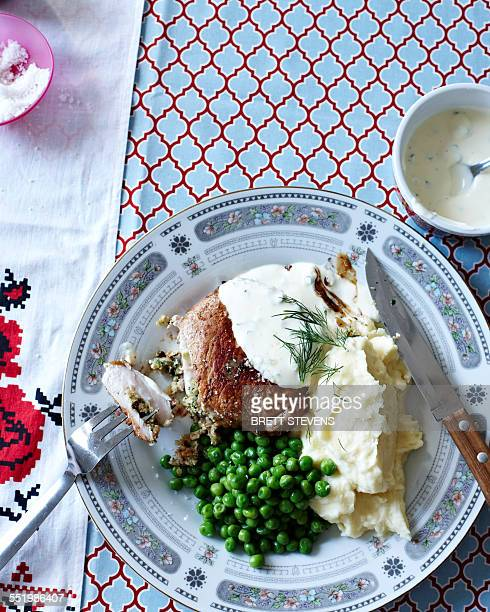 Still life of Ukrainian meal with plate of pork cutlets, mashed potato and peas