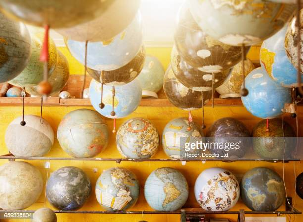 Still life of various globes in work shop