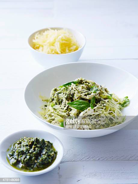 Still life of vegetable spaghetti with chicken pesto
