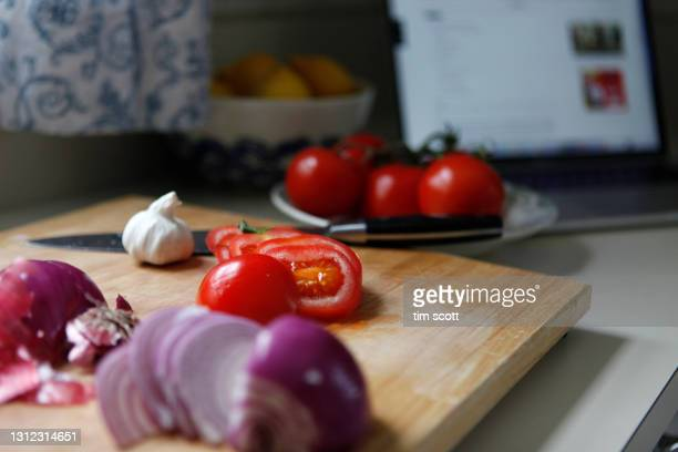 still life of vegetables on a cutting board, laptop on counter - ripe stock pictures, royalty-free photos & images