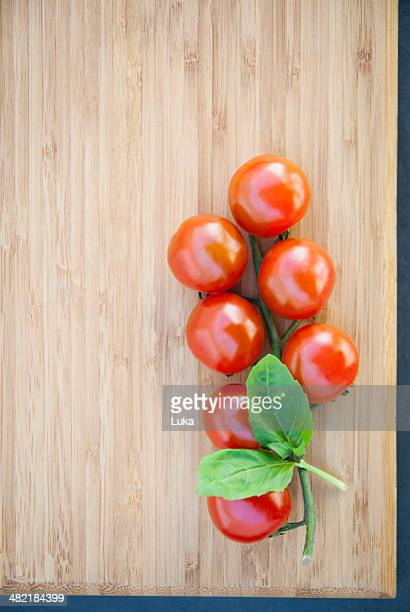 Still life of vine tomatoes with basil leaf