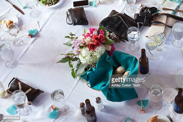 Still life of wedding reception table with drinks and purses