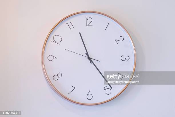 """a still life of white clock on the wall""""r - wall clock stock pictures, royalty-free photos & images"""
