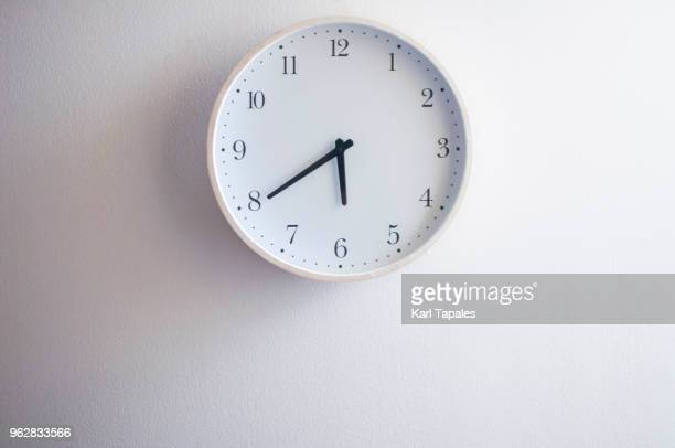 a still life of white clock - clock stock pictures, royalty-free photos & images