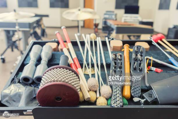 still life photo of hand held percussion instruments in music studio - percussion mallet stock pictures, royalty-free photos & images