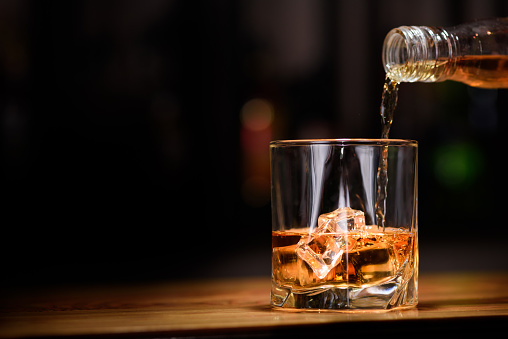Still life. pour or whiskey in to glass 490361148