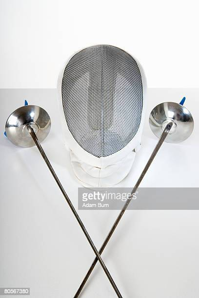 still life studio shot of two fencing foils and a fencing mask - face guard sport stock pictures, royalty-free photos & images