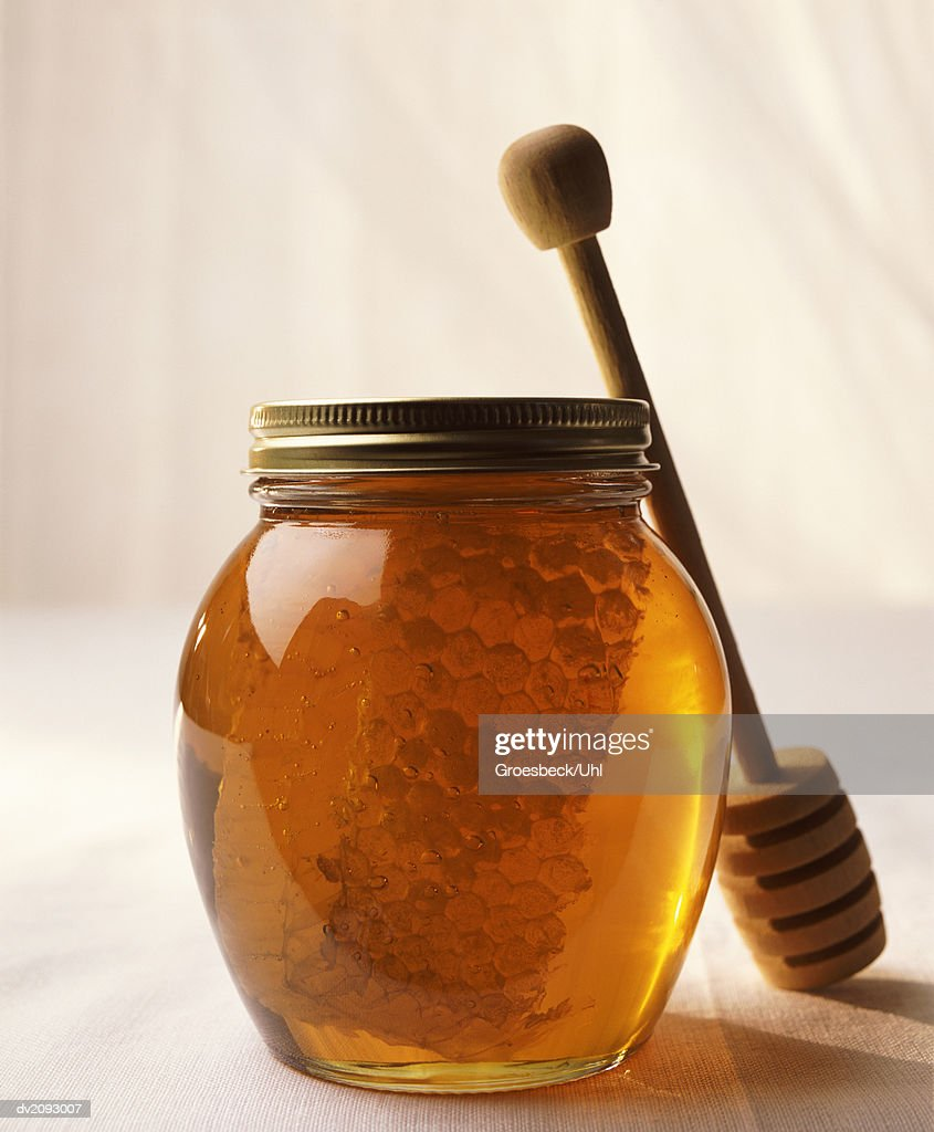 Still Life With a Jar of Honey and a Honey Drizzler : Stock Photo