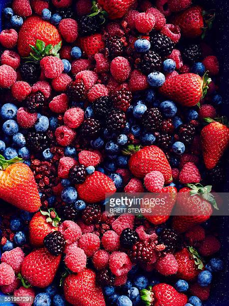 still life with abundance of strawberries, blackberries, blueberries, raspberries and cranberries - freshness stock pictures, royalty-free photos & images