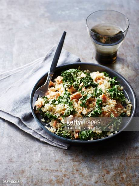 still life with bowl of quinoa salmon kale salad, overhead view - quinoa stock pictures, royalty-free photos & images