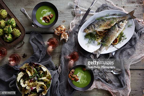 Still life with branzino fish and soup