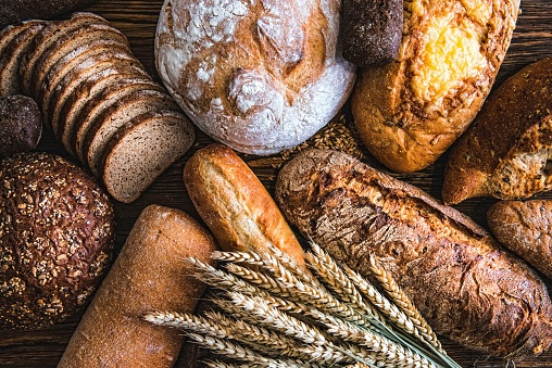 Still life with breads and wheats 1129408124