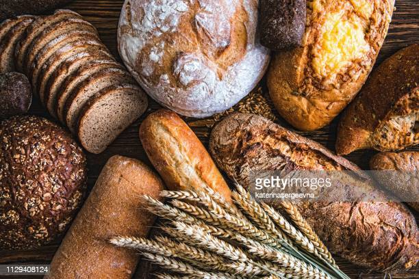 still life with breads and wheats - bread stock pictures, royalty-free photos & images