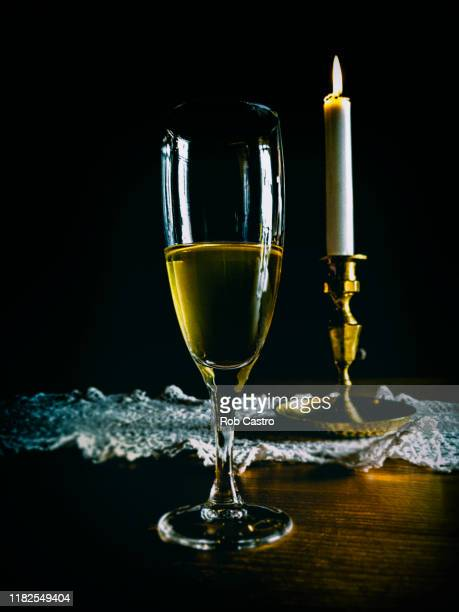 still life with candle and cider wine - rob castro stock pictures, royalty-free photos & images
