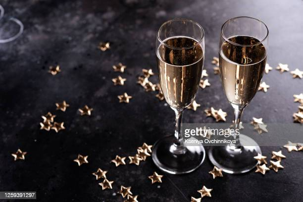 still life with champagne and festive bokeh background - maroon stock pictures, royalty-free photos & images
