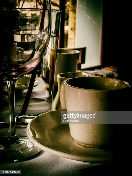still life with coffee cup and water - rob castro stock pictures, royalty-free photos & images