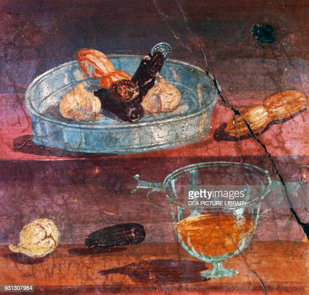 Still life with garlic dates and honey two gold and silver coins between the fruit wall painting from the House of the Deer Herculaneum Campania...
