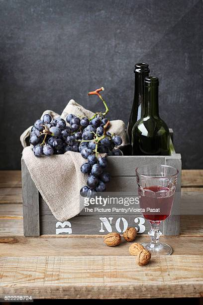 Still life with grapes,walnuts and wine
