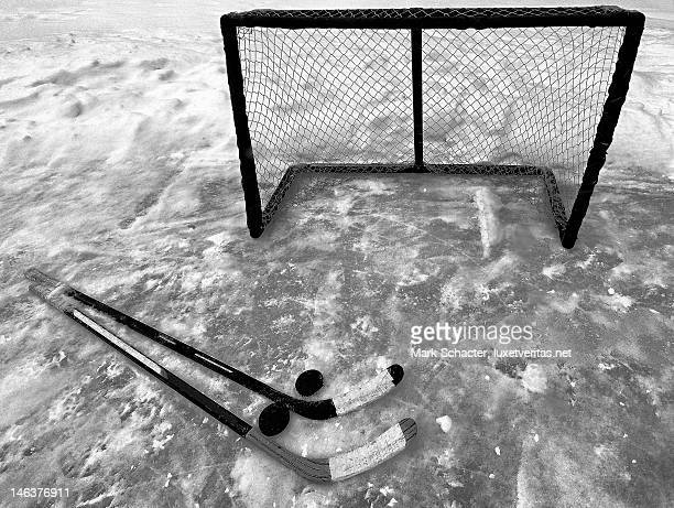 still life with hockey sticks - ice hockey rink stock pictures, royalty-free photos & images