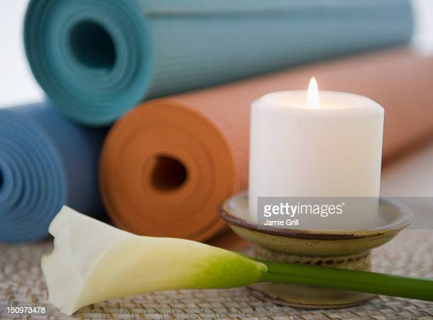 Still life with lily, candle and yoga mats