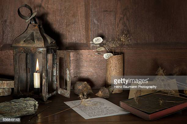 Still life with old stable lantern and books