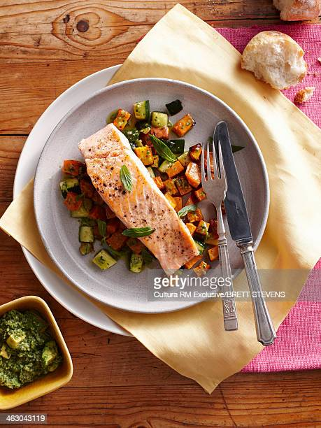 Still life with pan fried salmon and sweet potatoes