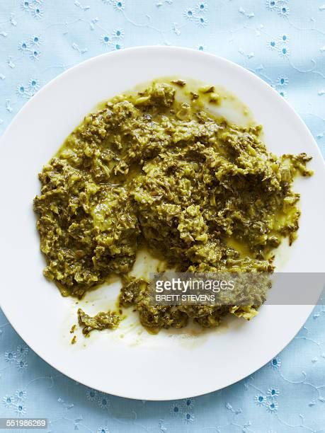 still life with plate of chimichurri sauce - チミチュリ・ソース ストックフォトと画像