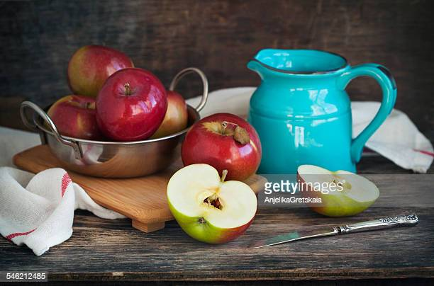Still life with red apples and turquoise jug