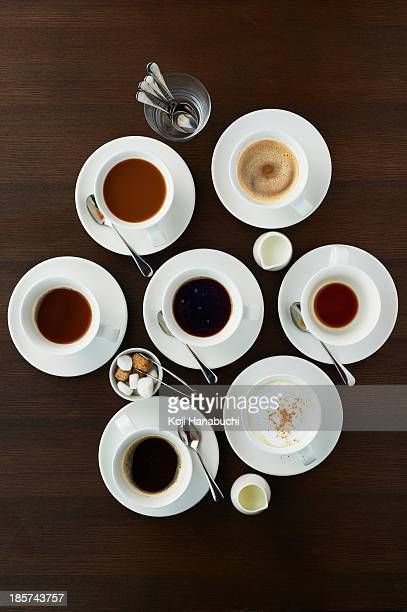 still life with selection of coffees in cups - sugar bowl crockery stock photos and pictures
