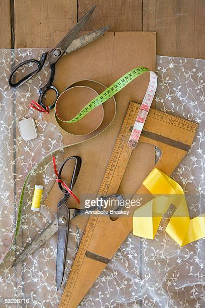 still life with sewing materials - ribbon sewing item stock pictures, royalty-free photos & images