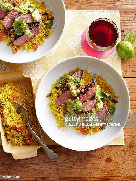 Still life with sliced fragrant lamb and nutty couscous