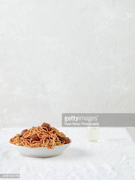 Still life with spaghetti and meatballs with white wine