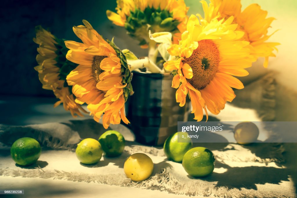 Still Life With Sunflowers And Lemons Stock Photo