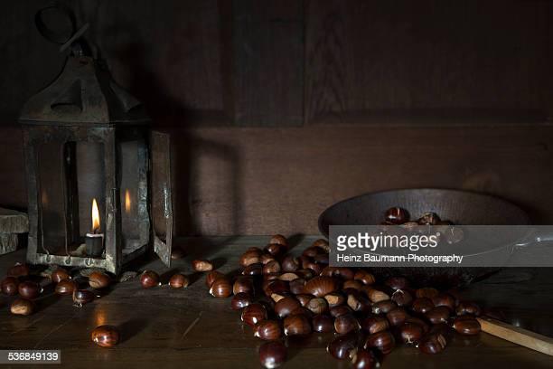 still life with sweet chestnuts - heinz baumann photography stock-fotos und bilder