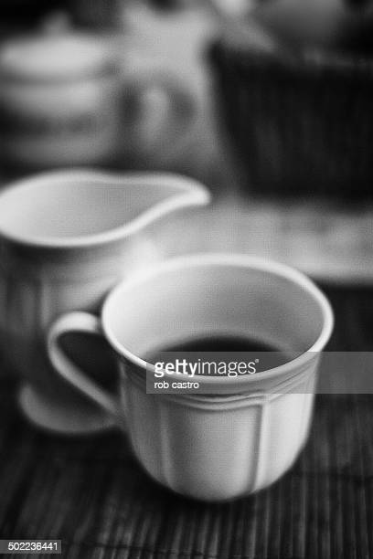still life with tea cup - rob castro stock pictures, royalty-free photos & images