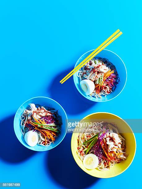 still life with three bowls of buckwheat spicy cold noodles - small group of objects stock pictures, royalty-free photos & images