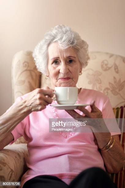 i still make a good cup of tea - one senior woman only stock pictures, royalty-free photos & images